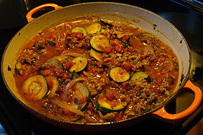 This red sauce is made with organic ground pork, onion, vegetable broth, crushed tomatoes, zucchini, chard and seasonings including oregano, basil, sea salt and pepper. I serve it over roasted spaghetti squash.